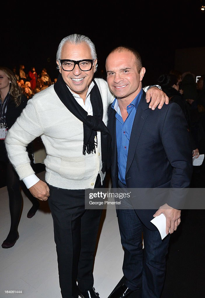 Joe Mimran and <a gi-track='captionPersonalityLinkClicked' href=/galleries/search?phrase=Tie+Domi&family=editorial&specificpeople=201528 ng-click='$event.stopPropagation()'>Tie Domi</a> attend World MasterCard Fashion Week Fall 2013 Collection at David Pecaut Square on March 18, 2013 in Toronto, Canada.