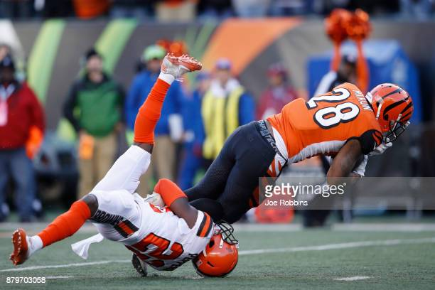 Joe Mixon of the Cincinnati Bengals runs over Jabrill Peppers of the Cleveland Browns in the second half of a game at Paul Brown Stadium on November...