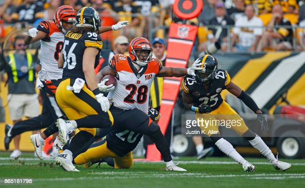 Joe Mixon of the Cincinnati Bengals stiff arms Artie Burns of the Pittsburgh Steelers as he carries the ball in the first half during the game at...