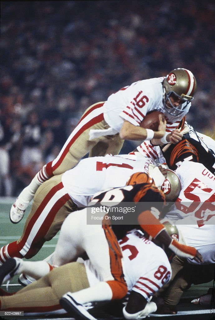 <a gi-track='captionPersonalityLinkClicked' href=/galleries/search?phrase=Joe+Montana&family=editorial&specificpeople=206967 ng-click='$event.stopPropagation()'>Joe Montana</a> #16 of the San Francisco 49ers dives over a pile of players to gain yardage against the Cincinnati Bengals during Superbowl XVI at the Silverdome on January 24, 1982 in Pontiac, Michigan. The Niners defeated the Bengals 26-21.