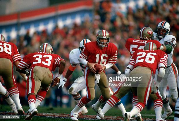Joe Montana of the San Francisco 49ers turns to hand off to Wendell Tyler against the Miami Dolphins during Super Bowl XIX on January 20 1985 at...