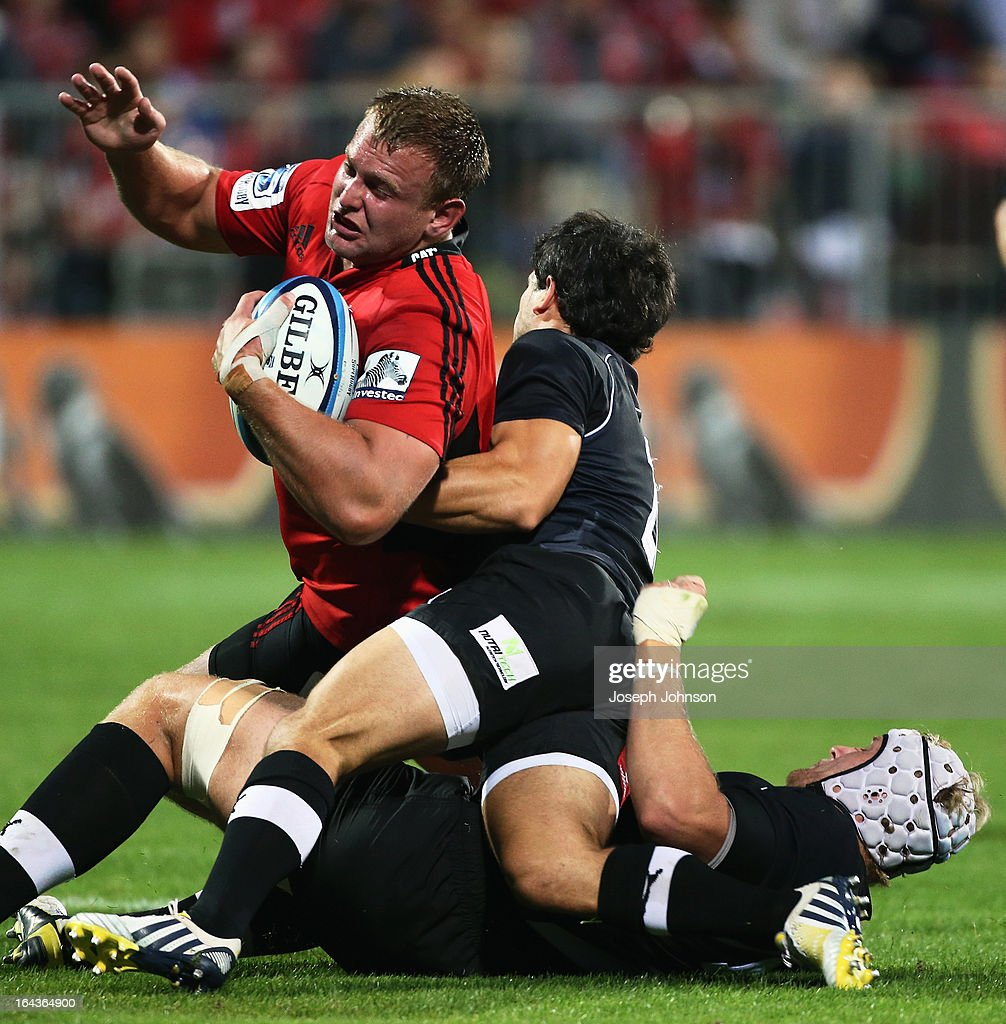 Joe Moody of the Crusaders is tackled by Nicholas Vergallo and Rynier Bernardo of the Kings during the round six Super Rugby match between the Crusaders and the Kings at AMI Stadium on March 23, 2013 in Christchurch, New Zealand.