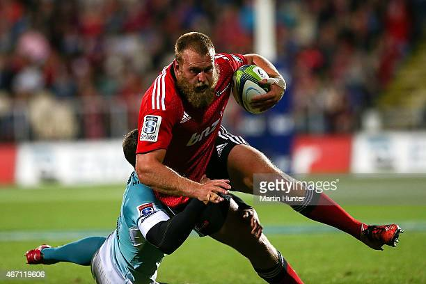 Joe Moody of the Crusaders is tackled during the round six Super Rugby match between the Crusaders and the Cheetahs at AMI Stadium on March 21 2015...