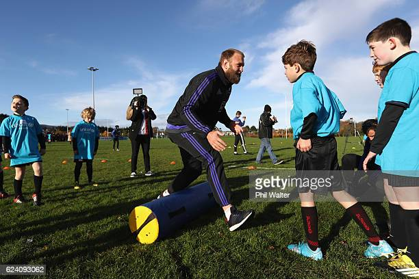 Joe Moody of the New Zealand All Blacks takes a rugby skills clinic with children at the Seapoint Rugby Club prior to their Captains Run on November...