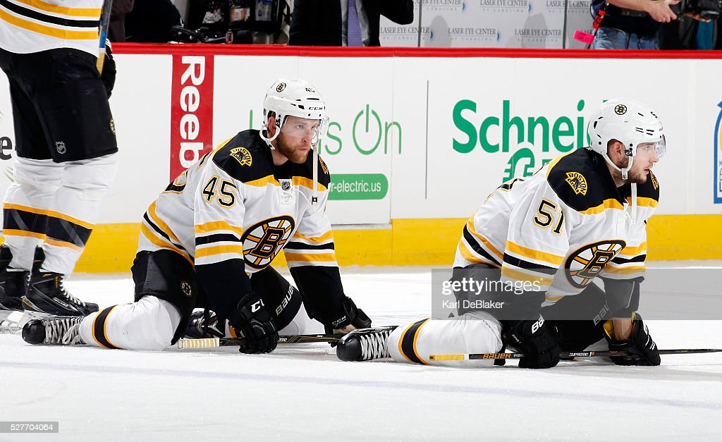 Joe Morrow and Ryan Spooner of the Boston Bruins stretch prior to an NHL game against the Carolina Hurricanes on February 26 2016 at PNC Arena in...