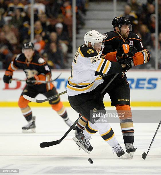 Joe Morrow of the Boston Bruins and Ryan Kesler of the Anaheim Ducks collide at the blue line during the first period at Honda Center on December 1...