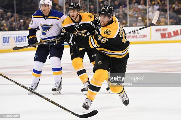 Joe Morrow of the Boston Bruins shoots the puck against the St Louis Blues at the TD Garden on November 22 2016 in Boston Massachusetts