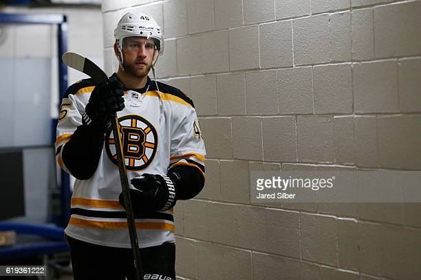 Joe Morrow of the Boston Bruins walks to the ice for pregame warmups before the game against the New York Rangers at Madison Square Garden on October...