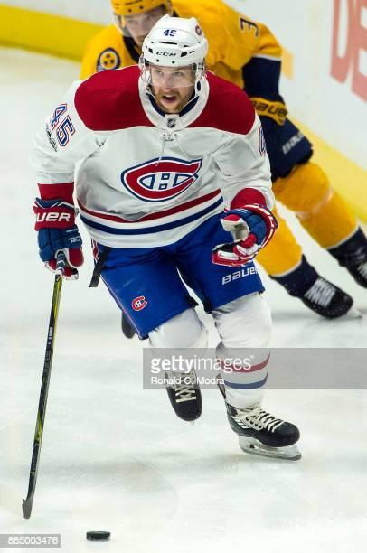 Joe Morrow of the Montreal Canadiens skates against the Nashville Predators during an NHL game at Bridgestone Arena on November 22 2017 in Nashville...