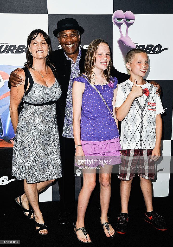 <a gi-track='captionPersonalityLinkClicked' href=/galleries/search?phrase=Joe+Morton&family=editorial&specificpeople=243160 ng-click='$event.stopPropagation()'>Joe Morton</a> (C) attends the 'Turbo' New York Premiere at AMC Loews Lincoln Square on July 9, 2013 in New York City.