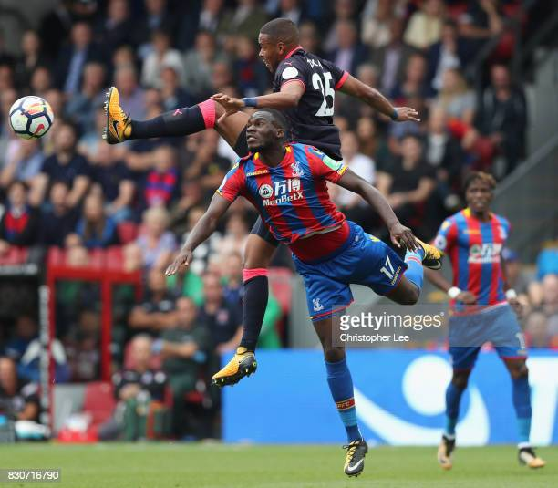 Joe Murphy of Huddersfield Town and Christian Benteke of Crystal Palace battle for possession during the Premier League match between Crystal Palace...
