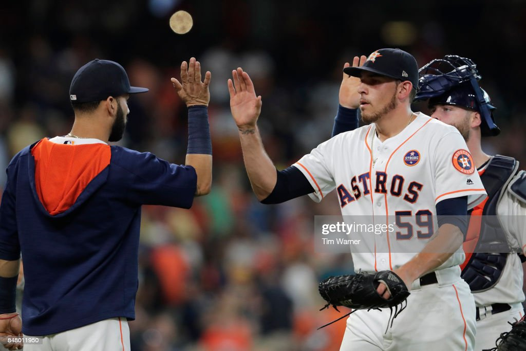 Joe Musgrove #59 of the Houston Astros celebrates with Marwin Gonzalez #9 after the game against the Seattle Mariners at Minute Maid Park on September 16, 2017 in Houston, Texas.