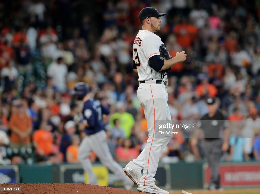 Joe Musgrove #59 of the Houston Astros reacts on the mound as after a home run as Mitch Haniger #17 of the Seattle Mariners rounds third base in the ninth inning at Minute Maid Park on September 16, 2017 in Houston, Texas.