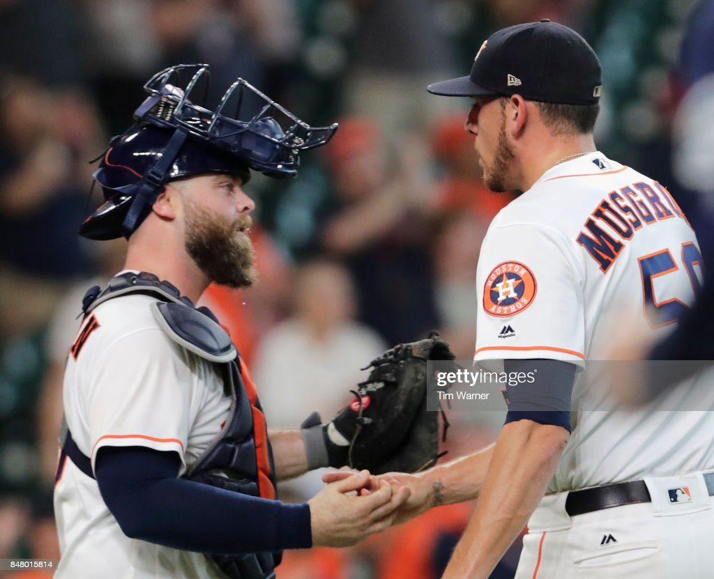 Joe Musgrove #59 of the Houston Astros shakes hands with Brian McCann #16 after the game against the Seattle Mariners at Minute Maid Park on September 16, 2017 in Houston, Texas.