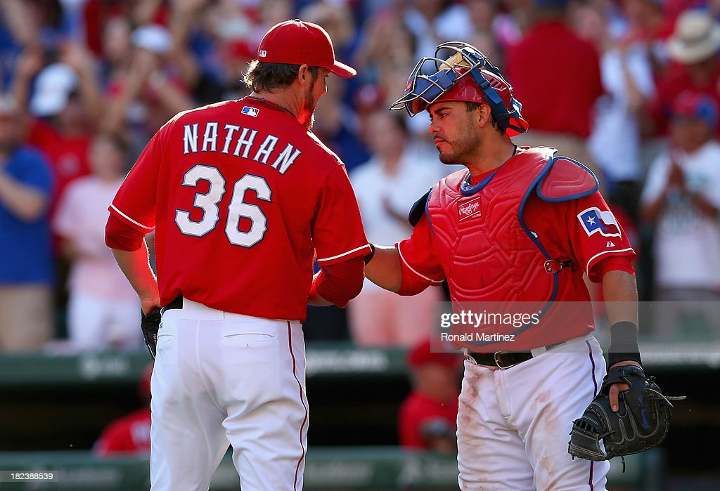 <a gi-track='captionPersonalityLinkClicked' href=/galleries/search?phrase=Joe+Nathan&family=editorial&specificpeople=215405 ng-click='$event.stopPropagation()'>Joe Nathan</a> #36 and <a gi-track='captionPersonalityLinkClicked' href=/galleries/search?phrase=Geovany+Soto&family=editorial&specificpeople=743668 ng-click='$event.stopPropagation()'>Geovany Soto</a> #8 of the Texas Rangers celebrate after a 6-2 win against the Los Angeles Angels at Rangers Ballpark in Arlington on September 29, 2013 in Arlington, Texas. The Rangers will now play a American League Wild Card tie-breaker game on Monday September 30, 2013.