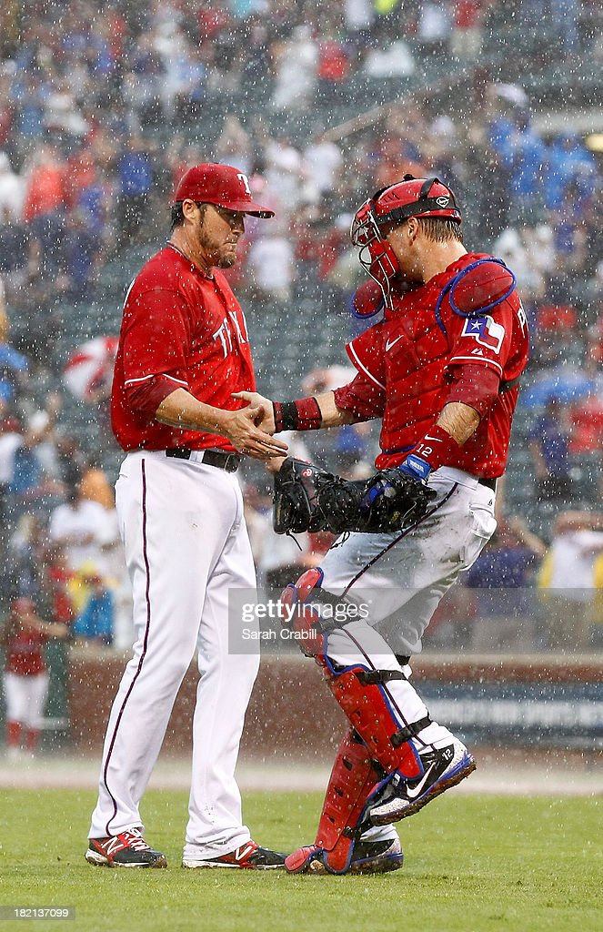 Joe Nathan #36 of the Texas Rangers celebrates with A.J. Pierzynski #12 after a game against the Los Angeles Angels of Anaheim at Rangers Ballpark in Arlington on September 28, 2013 in Arlington, Texas. The Texas Rangers defeated the Los Angeles Angels of Anaheim 7-4.