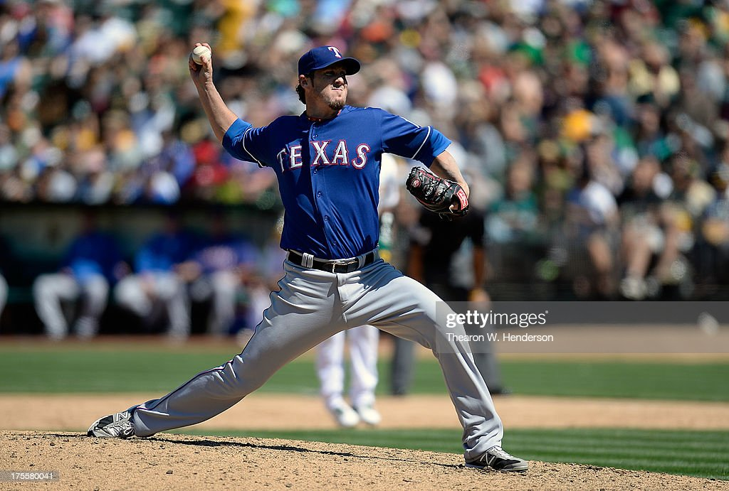 <a gi-track='captionPersonalityLinkClicked' href=/galleries/search?phrase=Joe+Nathan&family=editorial&specificpeople=215405 ng-click='$event.stopPropagation()'>Joe Nathan</a> #36 of the Texas Rangers pitches in the ninth inning against the Oakland Athletics at O.co Coliseum on August 4, 2013 in Oakland, California. The Rangers won the game 4-0.