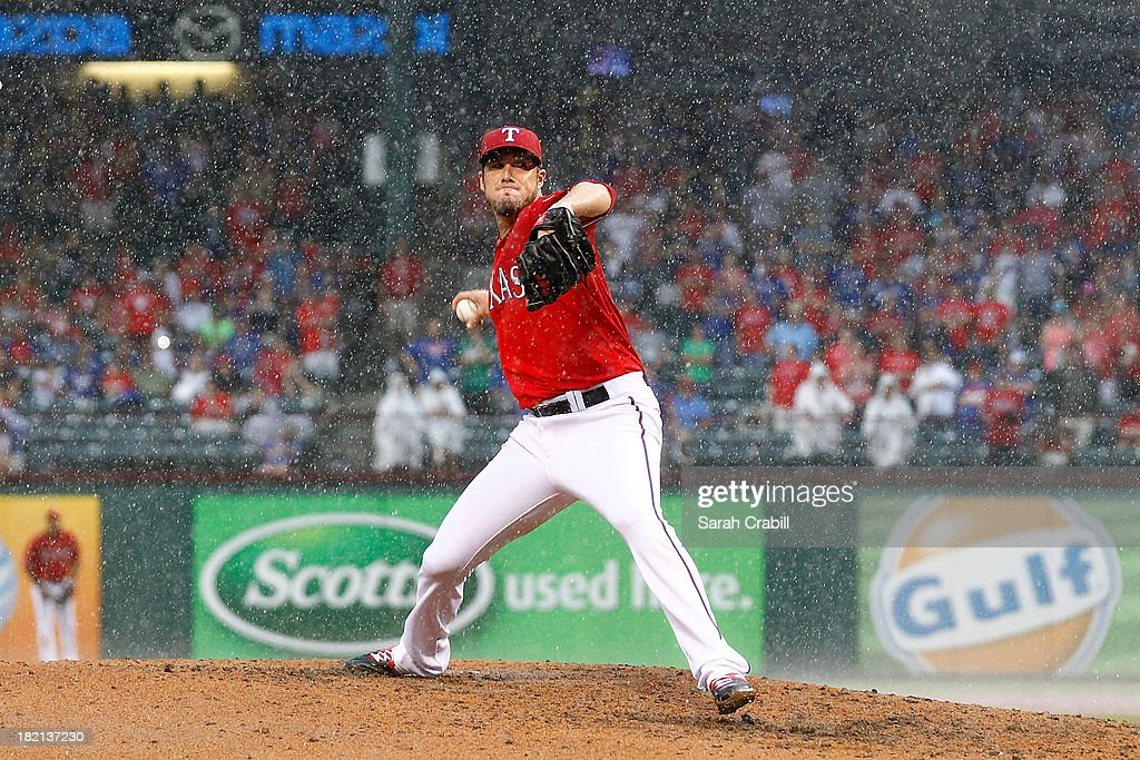 <a gi-track='captionPersonalityLinkClicked' href=/galleries/search?phrase=Joe+Nathan&family=editorial&specificpeople=215405 ng-click='$event.stopPropagation()'>Joe Nathan</a> #36 of the Texas Rangers pitches in the ninth inning during a game against the Los Angeles Angels of Anaheim at Rangers Ballpark in Arlington on September 28, 2013 in Arlington, Texas. The Texas Rangers defeated the Los Angeles Angels of Anaheim 7-4.