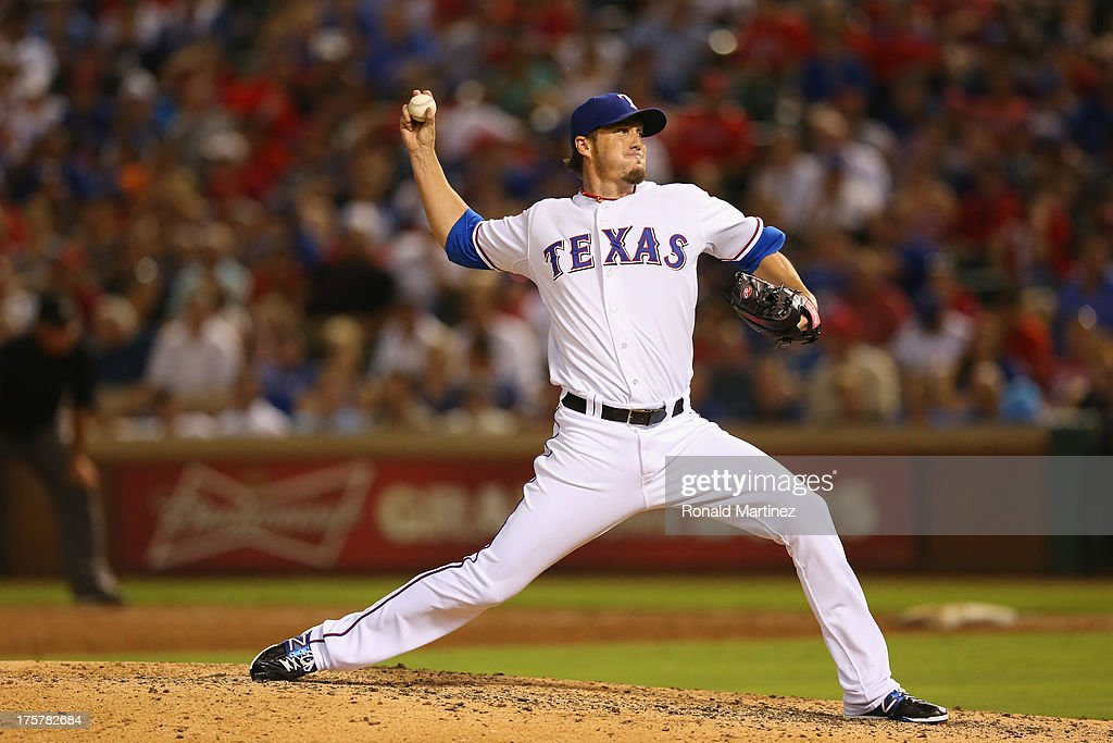 <a gi-track='captionPersonalityLinkClicked' href=/galleries/search?phrase=Joe+Nathan&family=editorial&specificpeople=215405 ng-click='$event.stopPropagation()'>Joe Nathan</a> #36 of the Texas Rangers throws against the Los Angeles Angels at Rangers Ballpark in Arlington on July 31, 2013 in Arlington, Texas.