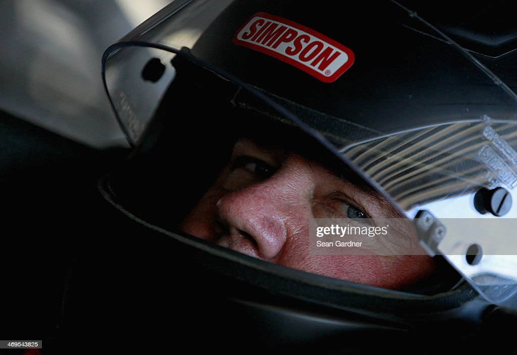 Joe Nemechek driver of the 300 Rise of an Empire Toyota sits in his car during practice for the NASCAR Sprint Cup Series Daytona 500 at Daytona...