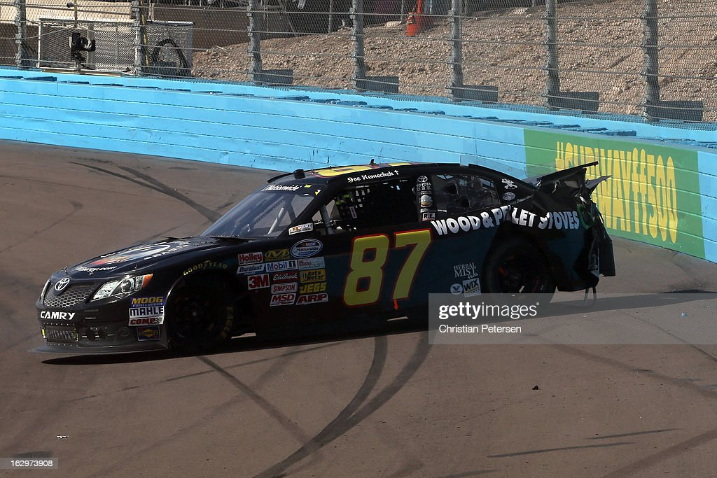 Joe Nemechek, driver of the #87 AM/FM Energy Toyota, spins out after suffering damage during the NASCAR Nationwide Series Dollar General 200 fueled by AmeriGas at Phoenix International Raceway on March 2, 2013 in Avondale, Arizona.