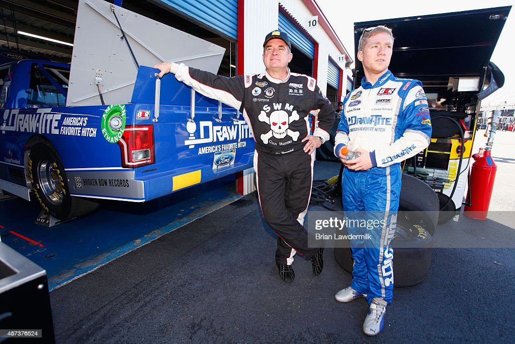 Joe Nemechek driver of the Bully Hill Vineyards Toyota talks to Tyler Reddick driver of the DrawTite Ford in the garage area during practice for the...