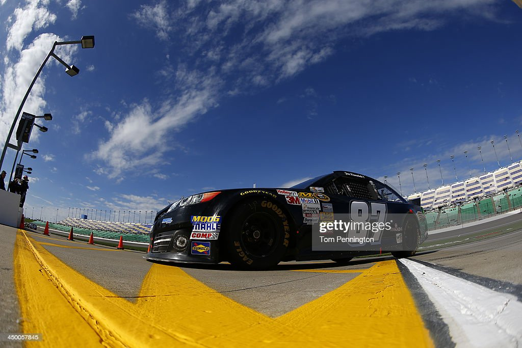 Joe Nemechek driver of the Calvert's Toyota during practice for the NASCAR Sprint Cup Series 13th Annual Hollywood Casino 400 at Kansas Speedway on...