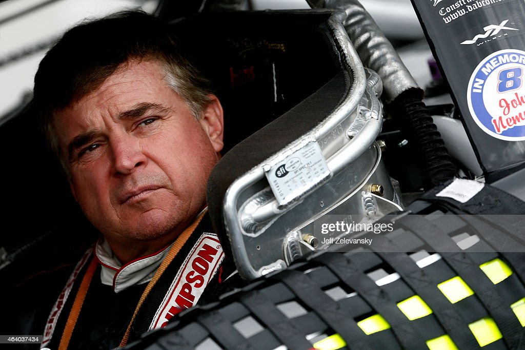 Joe Nemechek driver of the DAB Constructors Inc Chevrolet sits in his car on the grid during qualifying for the NASCAR XFINITY Series Alert Today...