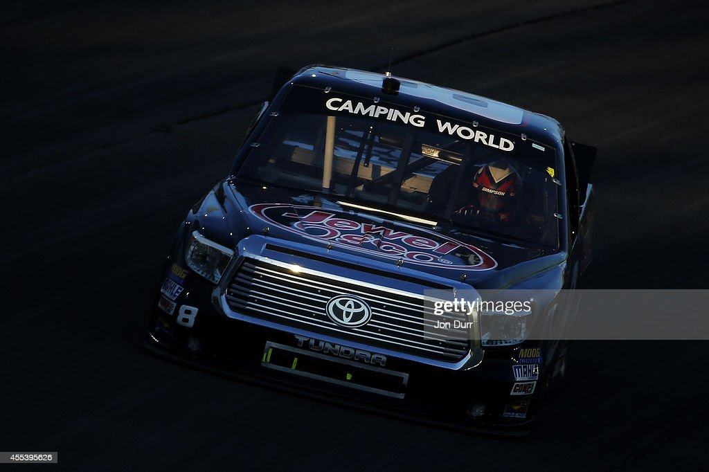 Joe Nemechek driver of the Jewel Osco Toyota races during the NASCAR Camping World Truck Series Lucas Oil 225 at Chicagoland Speedway on September 13...