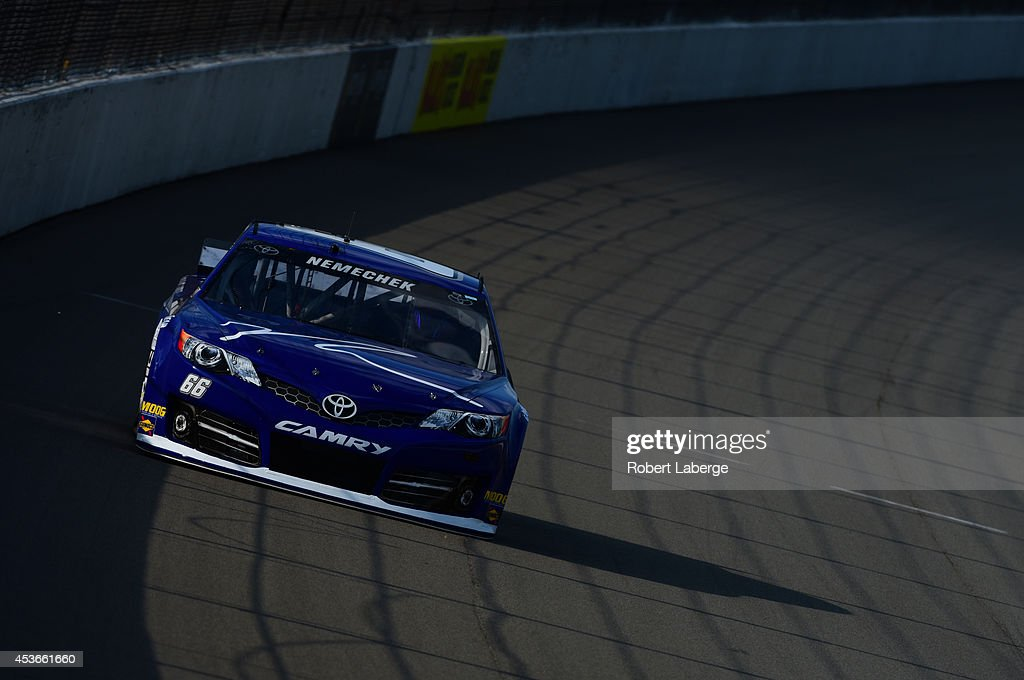 Joe Nemechek driver of the Land Castle Tile Toyota during qualifying for the NASCAR Sprint Cup Series Pure Michigan 400 at Michigan International...