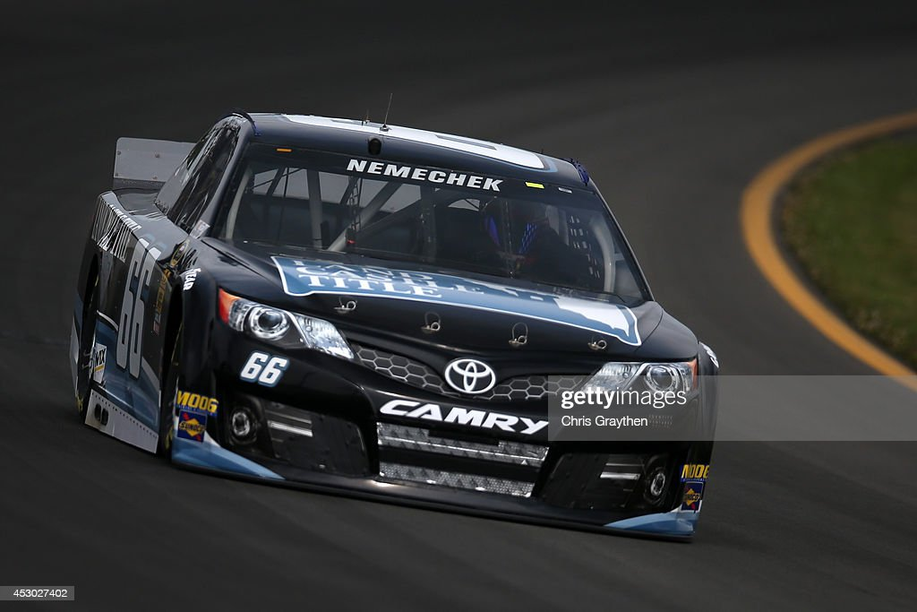 Joe Nemechek driver of the Land Castle Title Toyota drives during practice for the NASCAR Sprint Cup Series GoBowlingcom 400 at Pocono Raceway on...
