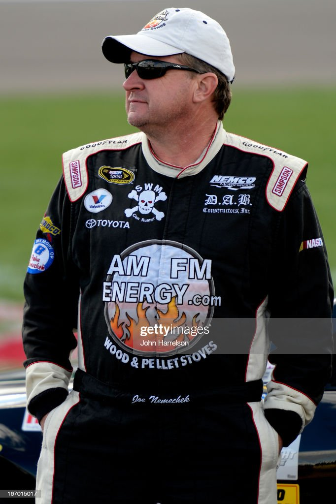 Joe Nemechek, driver of the #87 MaddiesPlaceRocks.com Toyota, stands on pit road during qualifying for the NASCAR Sprint Cup Series STP 400 at Kansas Speedway on April 19, 2013 in Kansas City, Kansas.