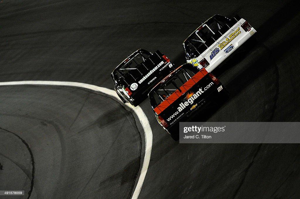 Joe Nemechek driver of the MDAnderson Cancer Center/SmokeNSear Toyota leads Scott Riggs driver of the BTSTire/Thrifty Tire/Goodyear Fleet HQ/Wynns...