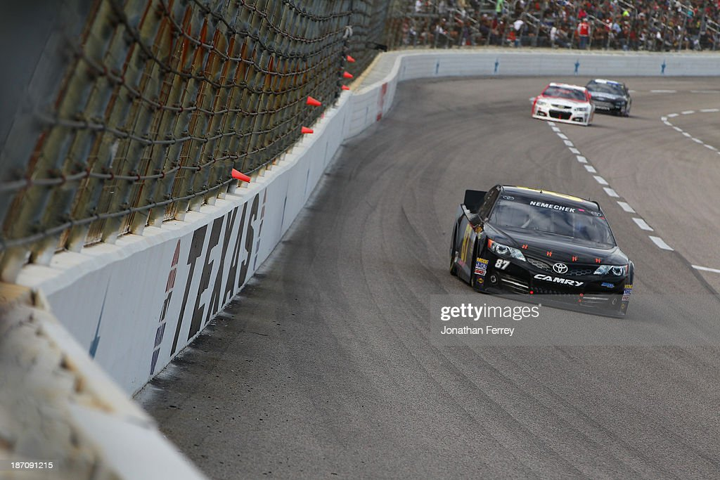 Joe Nemechek driver of the NEMCO JRR Toyota during the NASCAR Sprint Cup Series AAA Texas 500 at Texas Motor Speedway on November 3 2013 in Fort...