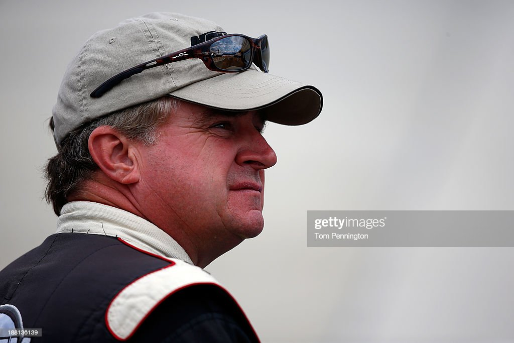 Joe Nemechek driver of the NEMCO Motorsports Toyota during qualifying for the NASCAR Sprint Cup Series AAA 400 at Dover International Speedway on...