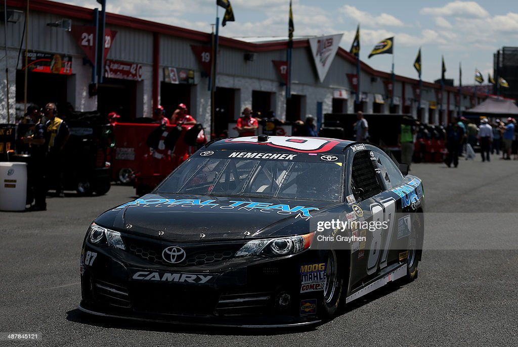 Joe Nemechek driver of the Royal Teak Collection Toyota drives through the garage area during practice for the NASCAR Sprint Cup Series Aaron's 499...