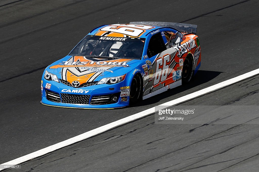 Joe Nemechek driver of the Testoril Toyota practices for the NASCAR Sprint Cup Series CocaCola 600 at Charlotte Motor Speedway on May 22 2014 in...