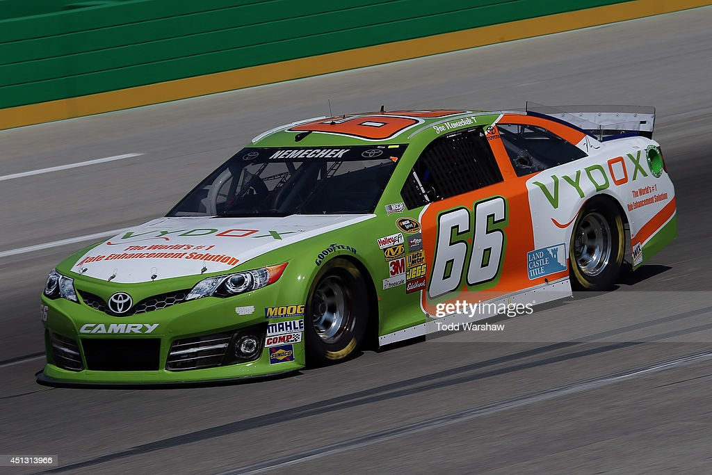 Joe Nemechek driver of the Vydox Toyota practices for the NASCAR Sprint Cup Series Quaker State 400 presented by Advance Auto Parts at Kentucky...