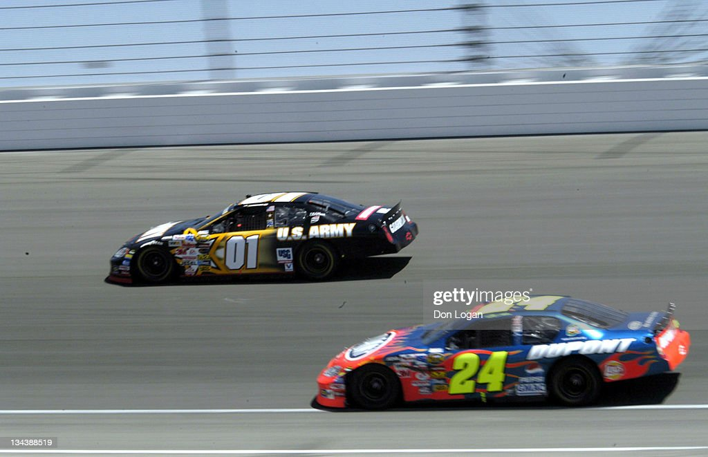 <a gi-track='captionPersonalityLinkClicked' href=/galleries/search?phrase=Joe+Nemechek&family=editorial&specificpeople=176518 ng-click='$event.stopPropagation()'>Joe Nemechek</a> runs the outside lane with <a gi-track='captionPersonalityLinkClicked' href=/galleries/search?phrase=Jeff+Gordon&family=editorial&specificpeople=171491 ng-click='$event.stopPropagation()'>Jeff Gordon</a> under him in the opening laps at the Auto Club 500 at the California Speedway in Fontana, California, May 2, 2004.