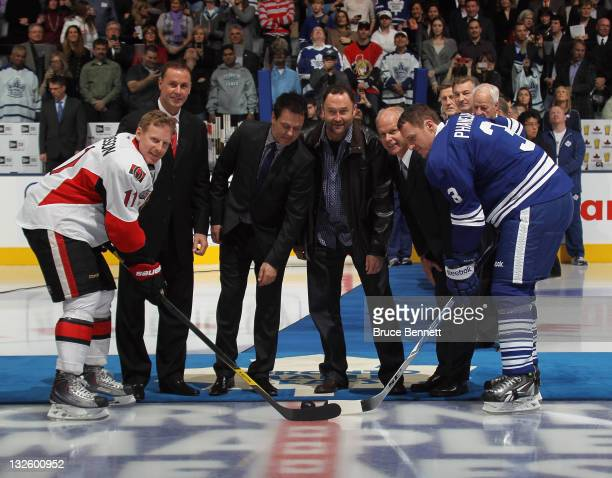 Joe Nieuwendyk Doug Gilmour Ed Belfour and Mark Howe prepare for the ceremonial faceoff prior between Daniel Alfredsson of the Ottawa Senatoras nd...