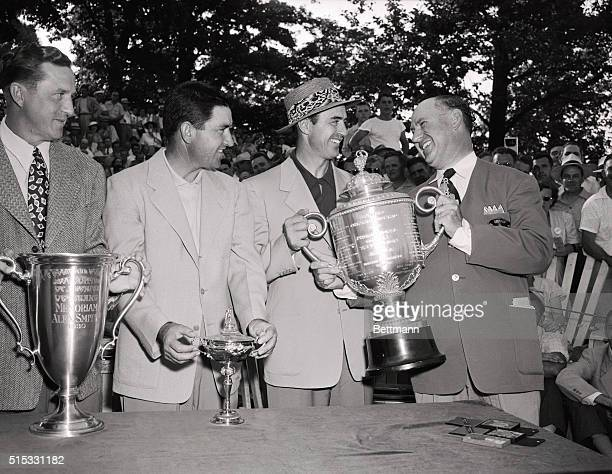 Joe Novak president of the Professional Golfers' Association presents PGA trophy to Sam Snead of White Sulphur Springs West Virginia after the latter...