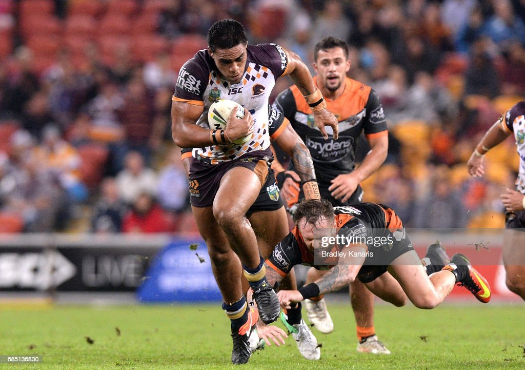 Joe Ofahengaue of the Broncos breaks through the defence during the round 11 NRL match between the Brisbane Broncos and the Wests Tigers at Suncorp Stadium on May 19, 2017 in Brisbane, Australia