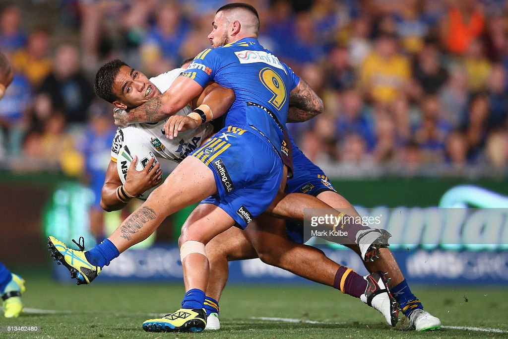 Joe Ofahengaue of the Broncos is tackled by Nathan Peats of the Eels during the round one NRL match between the Parramatta Eels and the Brisbane Broncos at Pirtek Stadium on March 3, 2016 in Sydney, Australia.