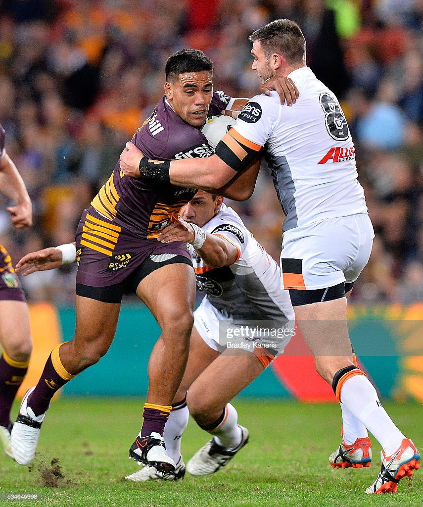 Joe Ofahengaue of the Broncos takes on the defence during the round 12 NRL match between the Brisbane Broncos and the Wests Tigers at Suncorp Stadium on May 27, 2016 in Brisbane, Australia.