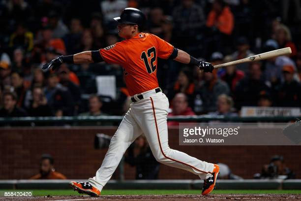 Joe Panik of the San Francisco Giants at bat against the San Diego Padres during the first inning at ATT Park on September 29 2017 in San Francisco...