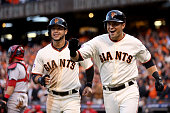 Joe Panik of the San Francisco Giants celebrates alongside Gregor Blanco after Panik hits a tworun home run in the third inning against the St Louis...