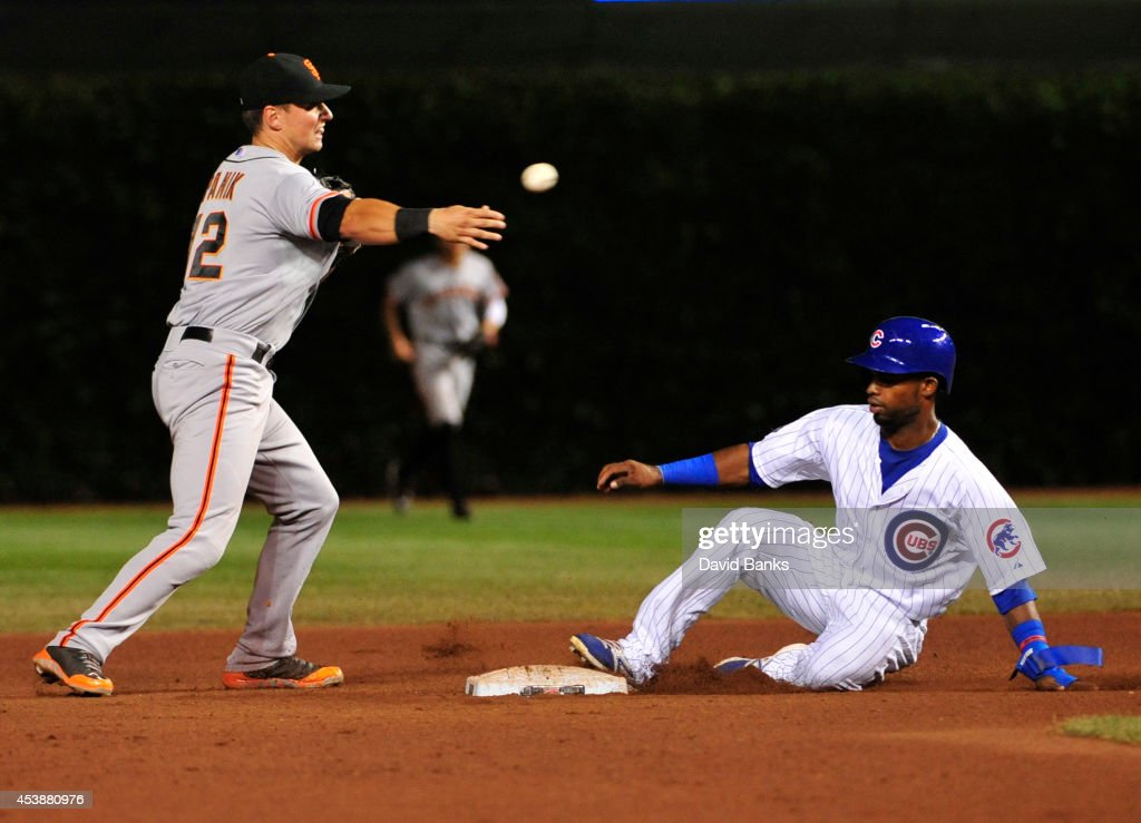 <a gi-track='captionPersonalityLinkClicked' href=/galleries/search?phrase=Joe+Panik&family=editorial&specificpeople=9008902 ng-click='$event.stopPropagation()'>Joe Panik</a> #12 of the San Francisco Giants forces out Arismendy Alcantara #7 of the Chicago Cubs during the fourth inning on August 20, 2014 at Wrigley Field in Chicago, Illinois.