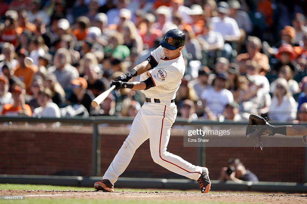 Joe Panik #12 of the San Francisco Giants hits a triple in the seventh inning against the Milwaukee Brewers at AT&T Park on August 31, 2014 in San Francisco, California.