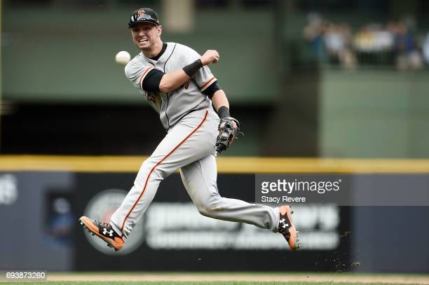 Joe Panik of the San Francisco Giants makes a throw to first base during the sixth inning of a game against the Milwaukee Brewers at Miller Park on...