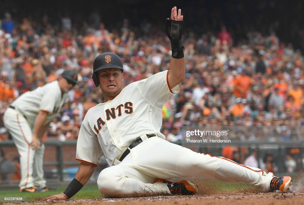 Joe Panik #12 of the San Francisco Giants scores against the St. Louis Cardinals in the bottom of the third inning at AT&T Park on September 3, 2017 in San Francisco, California.